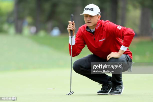 Mackenzie Hughes of Canada lines up his putt on the first hole during the first round of the 2017 Masters Tournament at Augusta National Golf Club on...