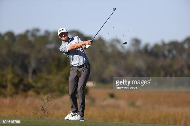 Mackenzie Hughes of Canada plays his second shot on the 8th hole during the final round of the RSM Classic at Sea Island Resort Seaside Course on...
