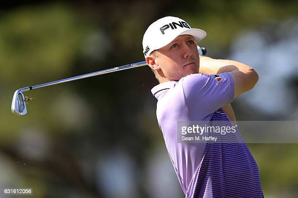 Mackenzie Hughes of Canada plays his shot from the fourth tee during the first round of the Sony Open In Hawaii at Waialae Country Club on January 12...