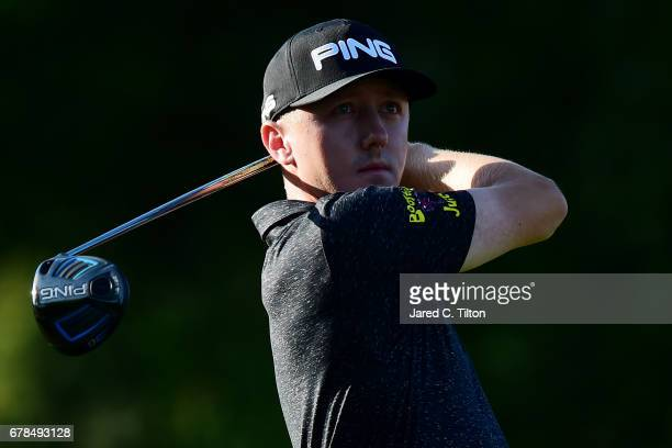 Mackenzie Hughes of Canada plays his shot from the third tee during round one of the Wells Fargo Championship at Eagle Point Golf Club on May 4 2017...