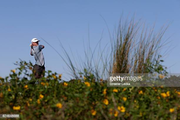 Mackenzie Hughes of Canada plays his tee shot on the 8th hole during the final round of the RSM Classic at Sea Island Resort Seaside Course on...