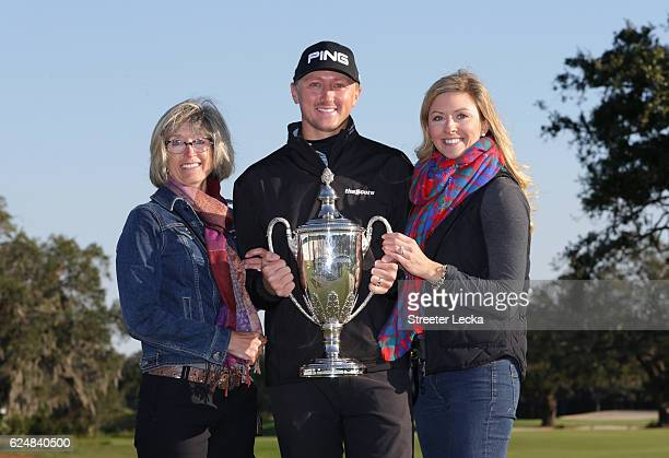 Mackenzie Hughes of Canada poses with his mother Sandra and wife Jenna after winning the playoff in the final round of the RSM Classic at Sea Island...