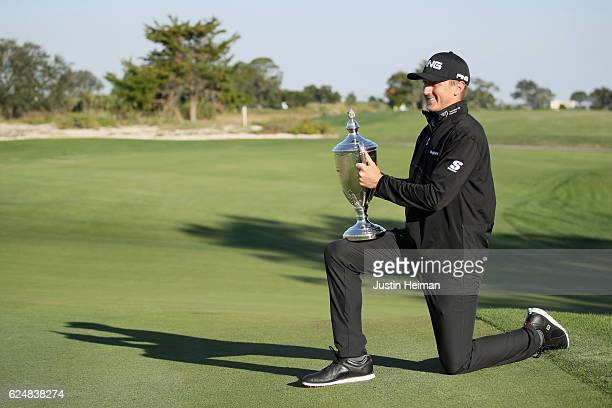 Mackenzie Hughes of Canada poses with his trophy after winning the playoff of the final round of the RSM Classic at Sea Island Resort Seaside Course...