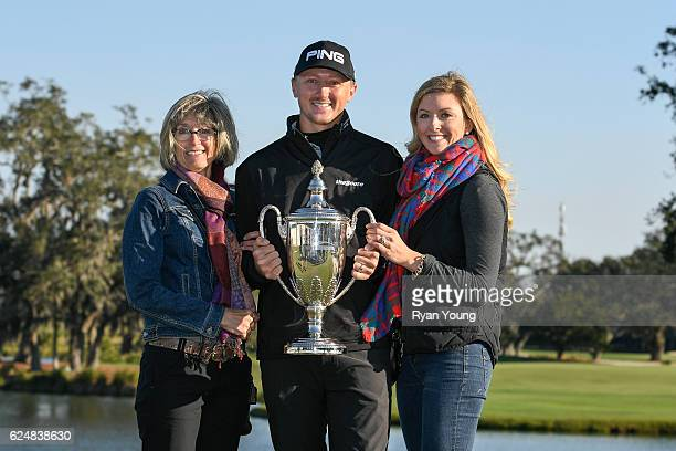 Mackenzie Hughes poses for a picture with his mother Sandra Hughes left and wife Jenna Hughes right during the playoff of the final round of The RSM...