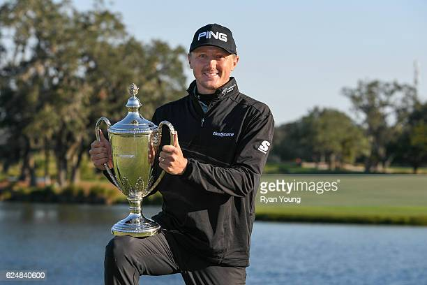 Mackenzie Hughes poses with the trophy following his victory in the playoff of the final round of The RSM Classic at Sea Island Resort Seaside Course...