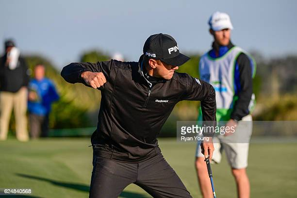 Mackenzie Hughes reacts after making a par putt on the 17th hole during the playoff of the final round of The RSM Classic at Sea Island Resort...