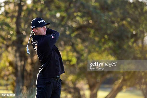 Mackenzie Hughes tees off on the 17th hole during the playoff of the final round of The RSM Classic at Sea Island Resort Seaside Course on November...