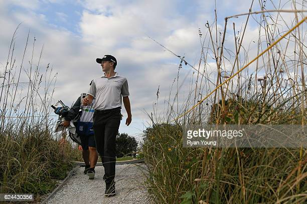 Mackenzie Hughes walks to the 17th hole during the third round of The RSM Classic at Sea Island Resort Seaside Course on November 19 2016 in Sea...