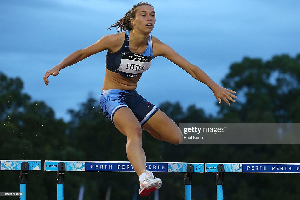 Mackenzie Little of New South Wales competes in the u18 400 metre hurdles final during day three of the Australian Junior Championships at the WA Athletics Stadium on March 14, 2013 in Perth, Australia.