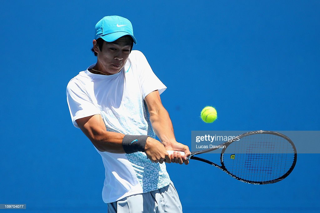 Mackenzie McDonald of the United States of America plays a backhand in his first round match against Duk-Young Kim of Korea during the 2013 Australian Open Junior Championships at Melbourne Park on January 19, 2013 in Melbourne, Australia.