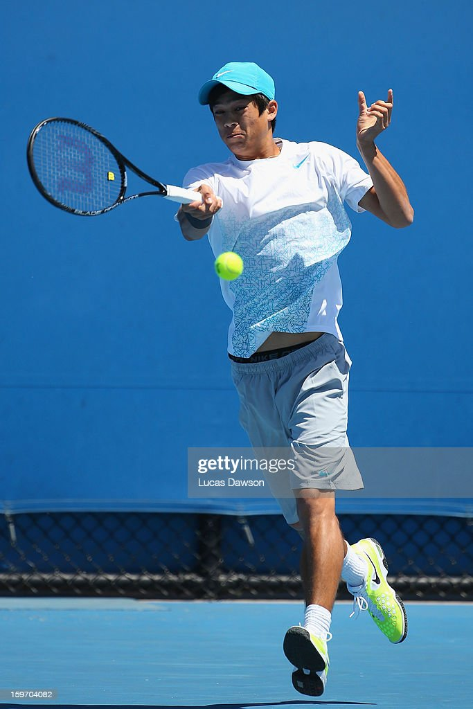 Mackenzie McDonald of the United States of America plays a forehand in his first round match against Duk-Young Kim of Korea during the 2013 Australian Open Junior Championships at Melbourne Park on January 19, 2013 in Melbourne, Australia.