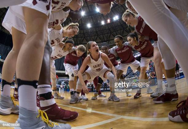 Mackenzie Rule of the St Joseph's Hawks yells at her team in the huddle prior to the game against the Duquesne Lady Dukes in the Semifinals of the...