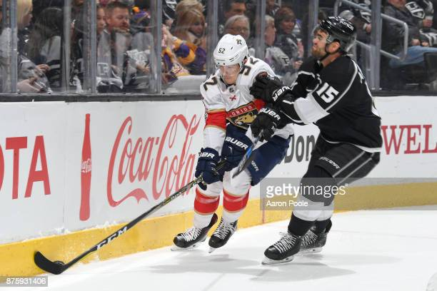 MacKenzie Weegar of the Florida Panthers battles for the puck against Andy Andreoff of the Los Angeles Kings at STAPLES Center on November 18 2017 in...