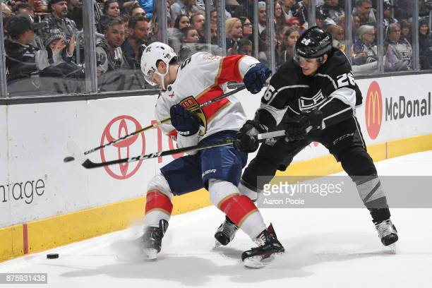 MacKenzie Weegar of the Florida Panthers battles for the puck against Nic Dowd of the Los Angeles Kings at STAPLES Center on November 18 2017 in Los...