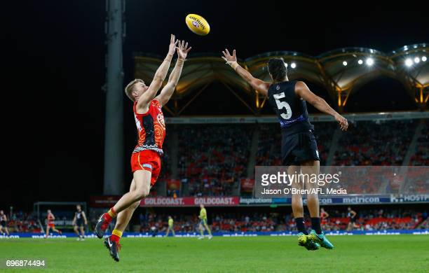 Mackenzie Willis of the Suns takes a mark during the round 13 AFL match between the Gold Coast Suns and the Carlton Blues at Metricon Stadium on June...