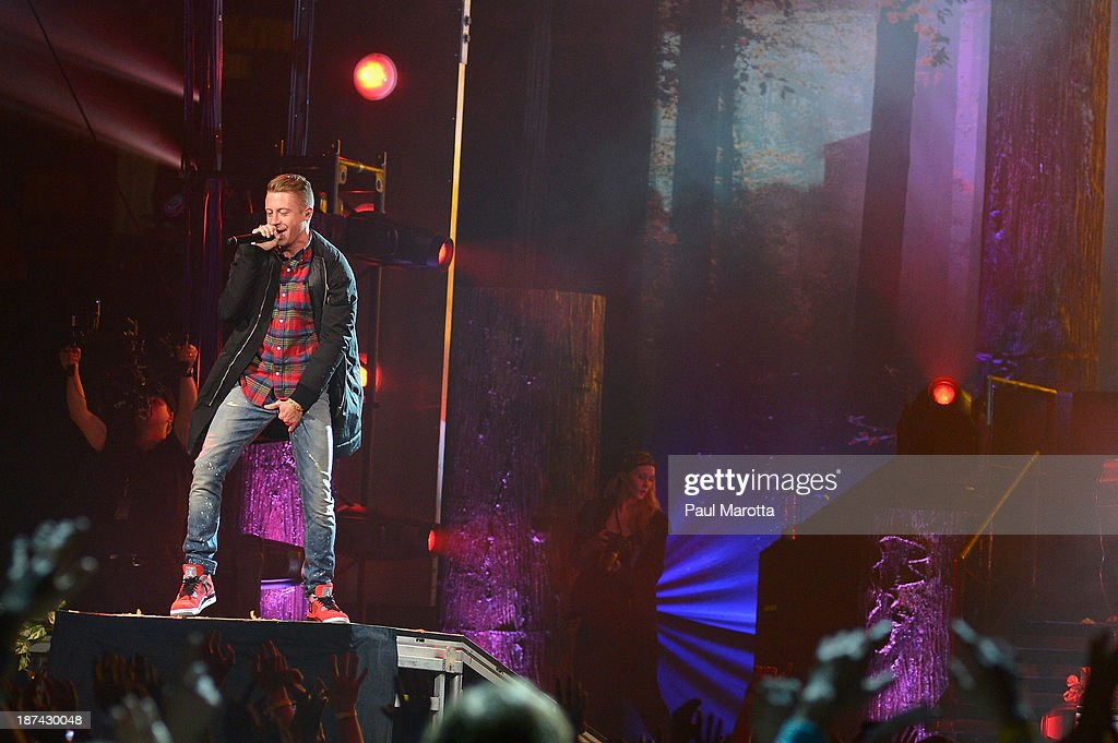 <a gi-track='captionPersonalityLinkClicked' href=/galleries/search?phrase=Macklemore&family=editorial&specificpeople=7639427 ng-click='$event.stopPropagation()'>Macklemore</a> and Ryan Lewis perform at TD Garden on November 8, 2013 in Boston, Massachusetts.