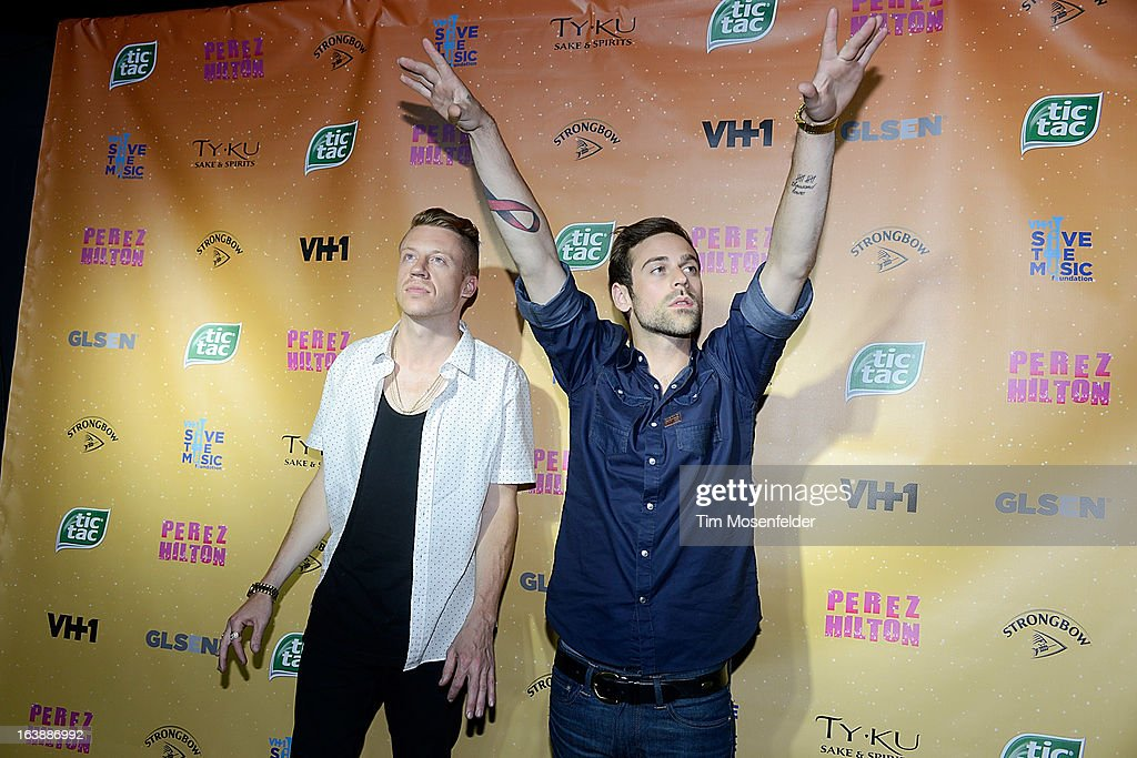 Macklemore (L) and Ryan Lewis pose on the red carpet for Perez Hilton's One Night In Austin event at the Austin Music Hall during the South By Southwest Music Festival on March 16, 2013 in Austin, Texas.