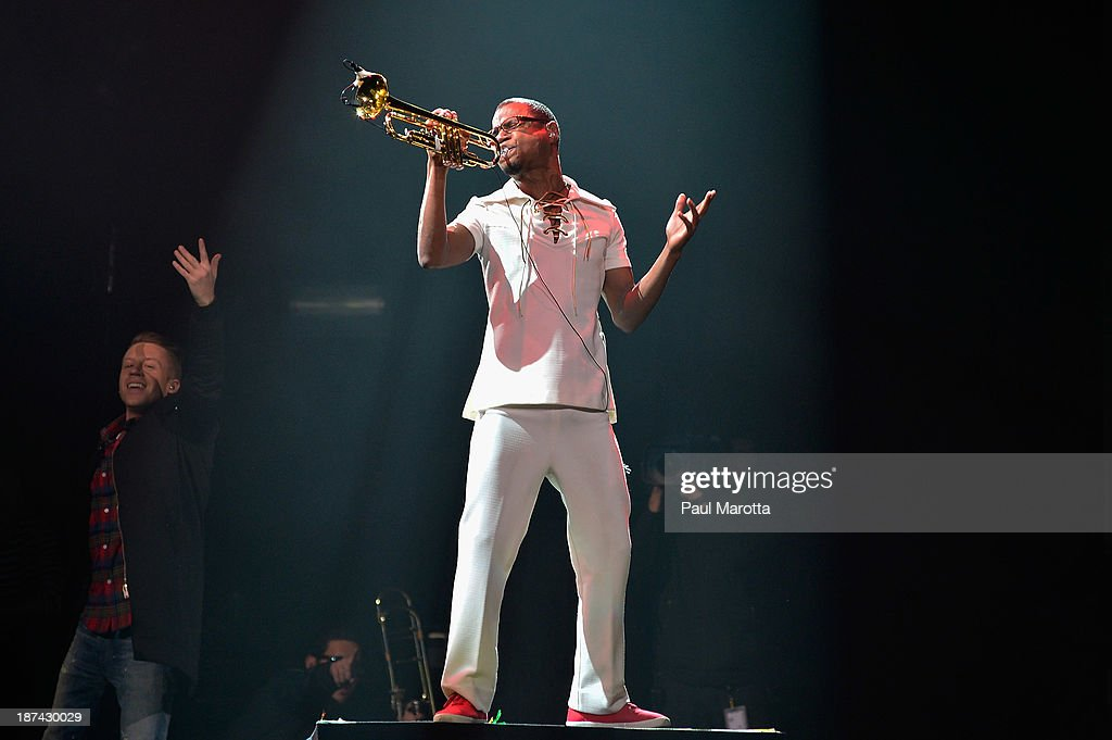 Macklemore and Ryan Lewis trumpet player Owuor Arunga perform at TD Garden on November 8, 2013 in Boston, Massachusetts.