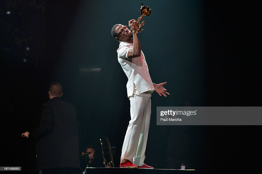<a gi-track='captionPersonalityLinkClicked' href=/galleries/search?phrase=Macklemore&family=editorial&specificpeople=7639427 ng-click='$event.stopPropagation()'>Macklemore</a> and Ryan Lewis trumpet player Owuor Arunga perform at TD Garden on November 8, 2013 in Boston, Massachusetts.