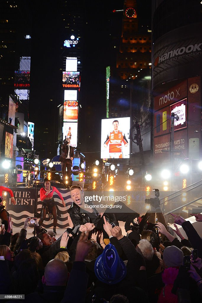 <a gi-track='captionPersonalityLinkClicked' href=/galleries/search?phrase=Macklemore&family=editorial&specificpeople=7639427 ng-click='$event.stopPropagation()'>Macklemore</a> at New Year's Eve Countdown at Times Square on December 31, 2013 in New York City.