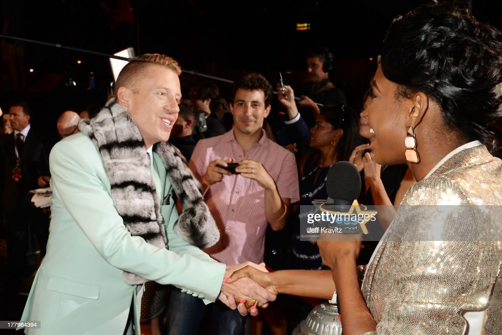 <a gi-track='captionPersonalityLinkClicked' href=/galleries/search?phrase=Macklemore&family=editorial&specificpeople=7639427 ng-click='$event.stopPropagation()'>Macklemore</a> is interviewed at the 2013 MTV Video Music Awards at the Barclays Center on August 25, 2013 in the Brooklyn borough of New York City.
