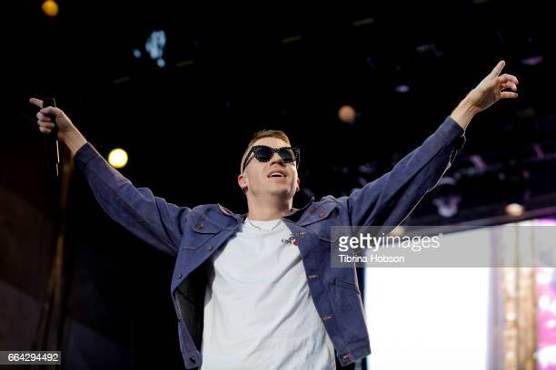 Macklemore of Macklemore and Ryan Lewis performs at the March Madness Music Festival on April 2 2017 in Margaret T Hance Park in Phoenix Arizona