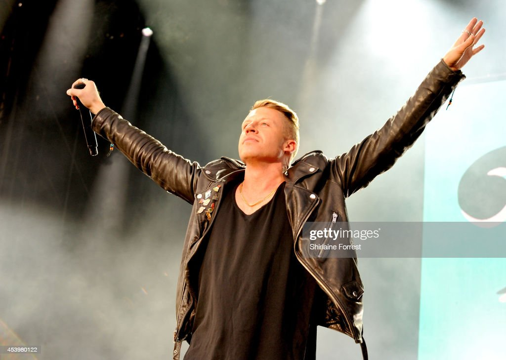 Macklemore of Macklemore and Ryan Lewis performs on Day 1 of the Leeds Festival at Bramham Park on August 22 2014 in Leeds England