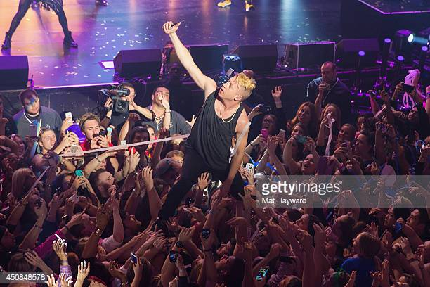 Macklemore of Macklemore and Ryan Lewis performs on stage as TMobile Unleashes Music Freedom at Paramount Theatre on June 18 2014 in Seattle...