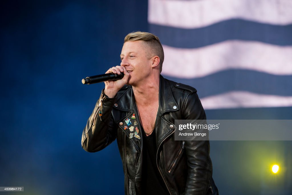 Macklemore of Macklemore Ryan Lewis performs on stage at Leeds Festival at Bramham Park on August 22 2014 in Leeds United Kingdom