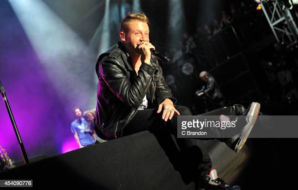 Macklemore of Macklemore Ryan Lewis performs on stage at the Reading Festival at Richfield Avenue on August 24 2014 in Reading United Kingdom
