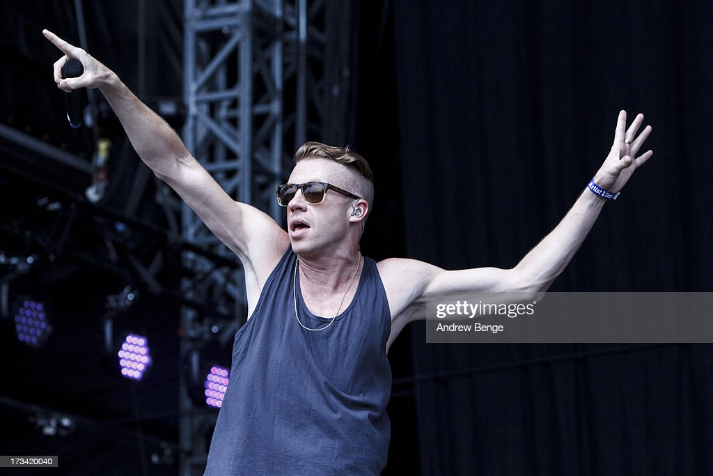 <a gi-track='captionPersonalityLinkClicked' href=/galleries/search?phrase=Macklemore&family=editorial&specificpeople=7639427 ng-click='$event.stopPropagation()'>Macklemore</a> of <a gi-track='captionPersonalityLinkClicked' href=/galleries/search?phrase=Macklemore&family=editorial&specificpeople=7639427 ng-click='$event.stopPropagation()'>Macklemore</a> & Ryan Lewis performs on stage on Day 2 of Yahoo Wireless Festival 2013 at Queen Elizabeth Olympic Park on July 13, 2013 in London, England.
