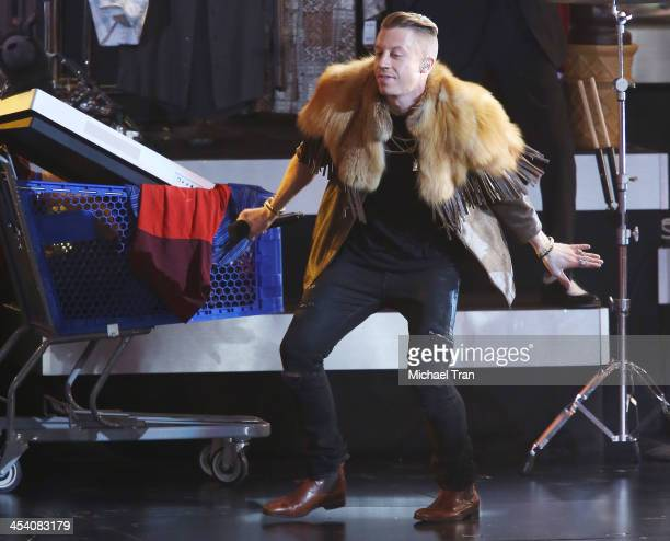Macklemore performs at the GRAMMY Nominations Concert Live held at Nokia Theatre LA Live on December 6 2013 in Los Angeles California