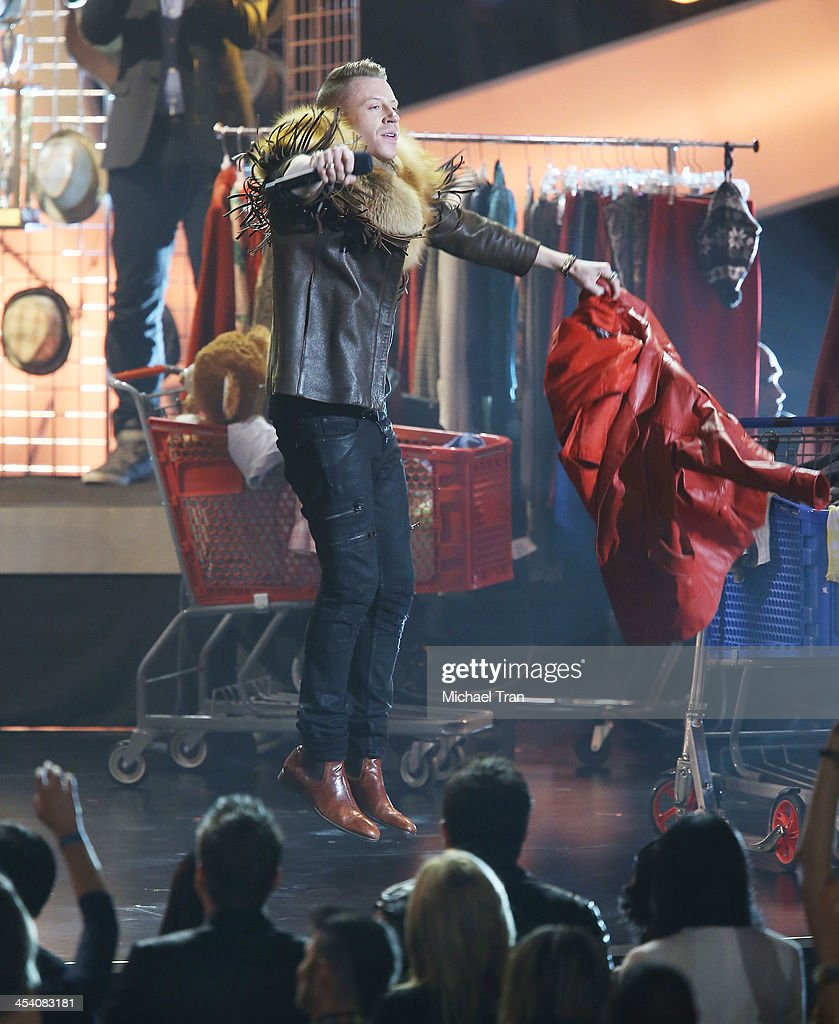 <a gi-track='captionPersonalityLinkClicked' href=/galleries/search?phrase=Macklemore&family=editorial&specificpeople=7639427 ng-click='$event.stopPropagation()'>Macklemore</a> performs at the GRAMMY Nominations Concert Live! held at Nokia Theatre L.A. Live on December 6, 2013 in Los Angeles, California.