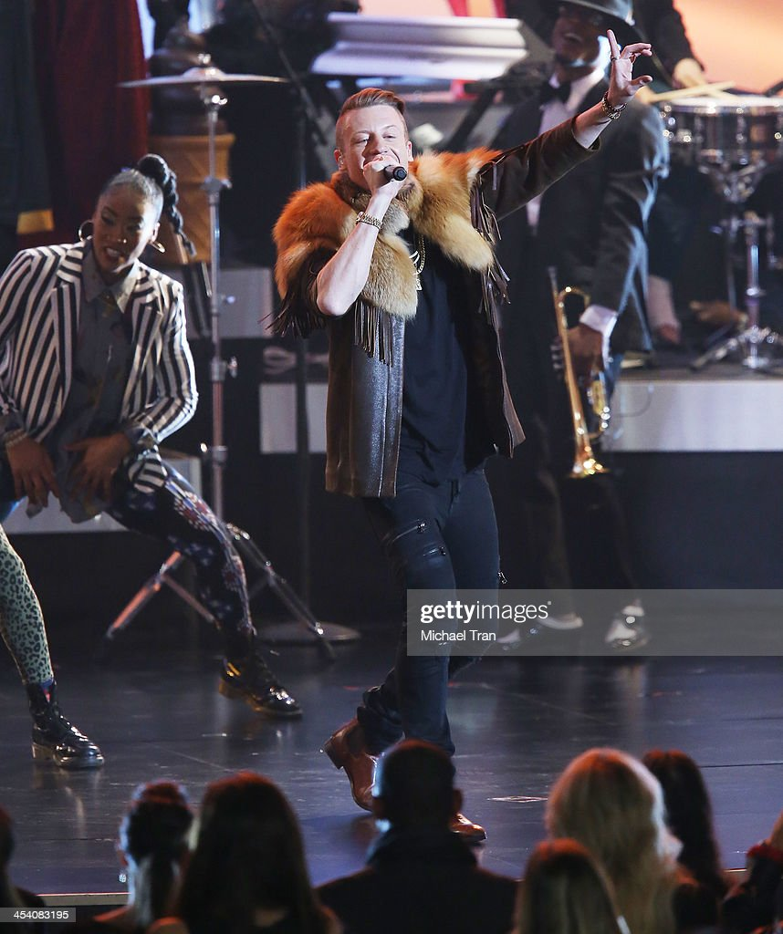 Macklemore performs at the GRAMMY Nominations Concert Live! held at Nokia Theatre L.A. Live on December 6, 2013 in Los Angeles, California.