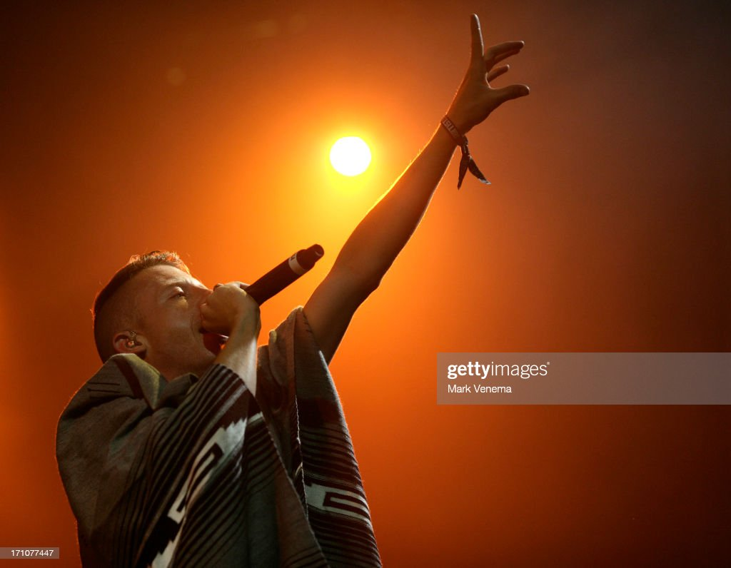 <a gi-track='captionPersonalityLinkClicked' href=/galleries/search?phrase=Macklemore&family=editorial&specificpeople=7639427 ng-click='$event.stopPropagation()'>Macklemore</a> performs on Day 1 of the Best Kept Secret Festival at Beekse Bergen on June 21, 2013 in Hilvarenbeek, Netherlands.