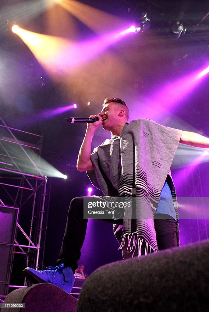 <a gi-track='captionPersonalityLinkClicked' href=/galleries/search?phrase=Macklemore&family=editorial&specificpeople=7639427 ng-click='$event.stopPropagation()'>Macklemore</a> performs on day one of the Best Kept Secret Festival at Beekse Bergen on June 21, 2013 in Hilvarenbeek, Netherlands.