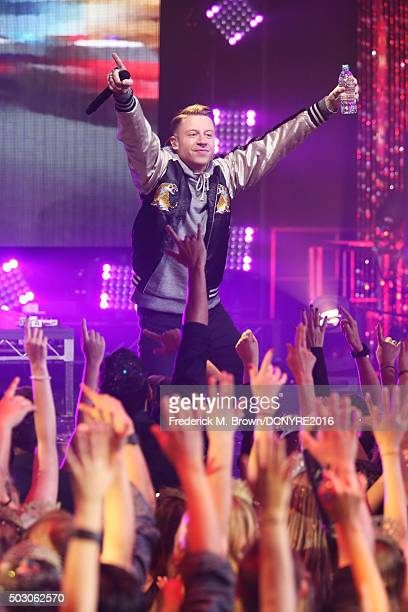 Macklemore performs onstage at Dick Clark's New Year's Rockin' Eve with Ryan Seacrest 2016 on December 31 2015 in Los Angeles CA