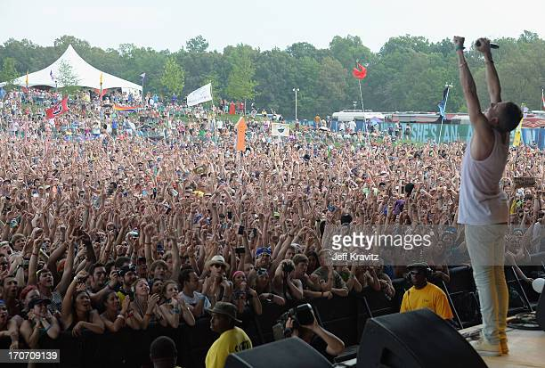 Macklemore performs onstage with Ryan Lewis at What Stage during day 4 of the 2013 Bonnaroo Music Arts Festival on June 16 2013 in Manchester...