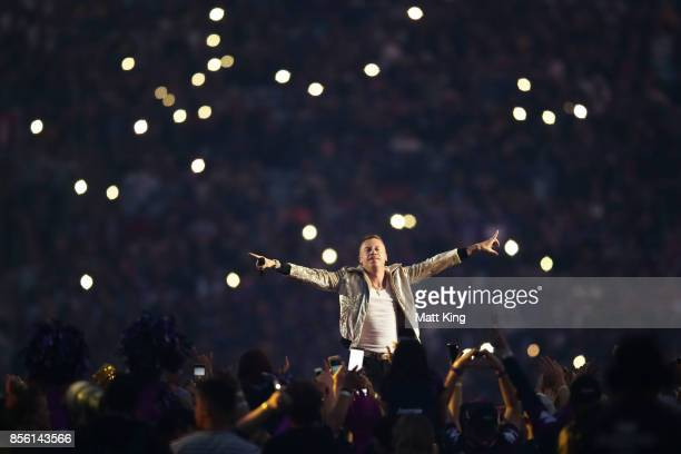 Macklemore performs prior to the 2017 NRL Grand Final match between the Melbourne Storm and the North Queensland Cowboys at ANZ Stadium on October 1...