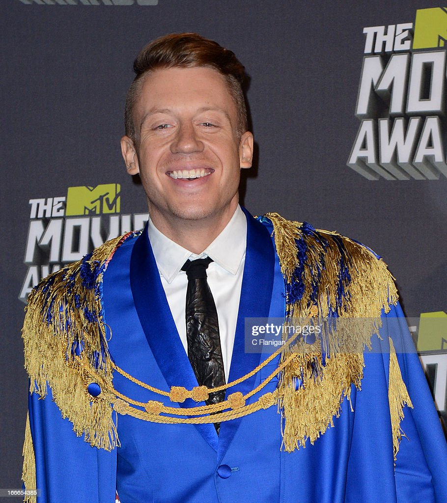 <a gi-track='captionPersonalityLinkClicked' href=/galleries/search?phrase=Macklemore&family=editorial&specificpeople=7639427 ng-click='$event.stopPropagation()'>Macklemore</a> poses backstage during the 2013 MTV Movie Awards at Sony Pictures Studios on April 14, 2013 in Culver City, California.