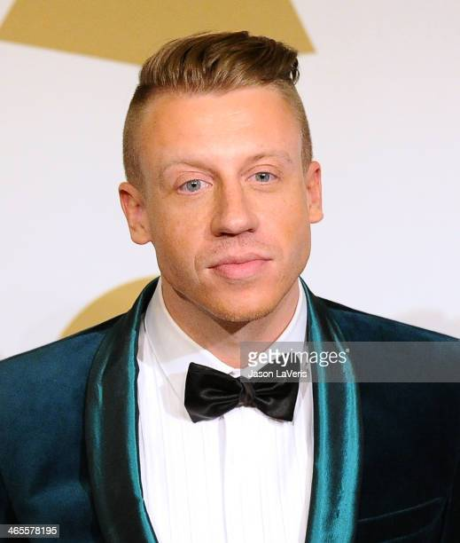 Macklemore poses in the press room at the 56th GRAMMY Awards at Staples Center on January 26 2014 in Los Angeles California