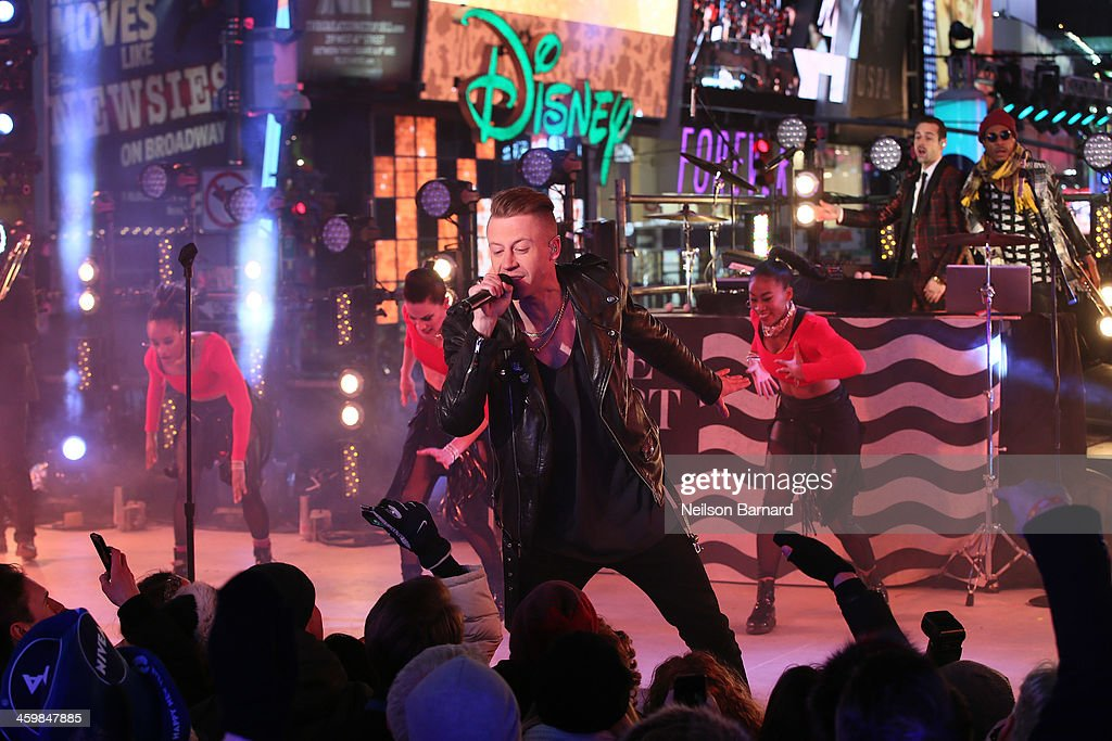 Macklemore & Ryan Lewis peform on stage during The New Year's Eve 2014 Celebration in Times Square on December 31, 2013 in New York City.