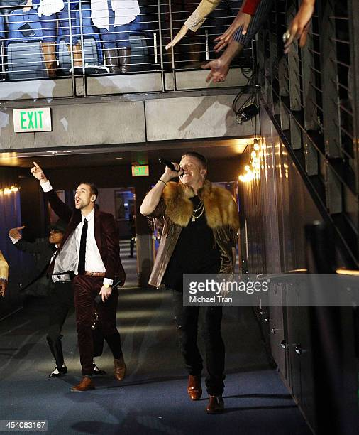 Macklemore Ryan Lewis perform at the GRAMMY Nominations Concert Live held at Nokia Theatre LA Live on December 6 2013 in Los Angeles California