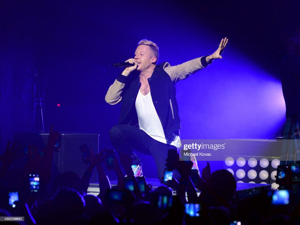 <a gi-track='captionPersonalityLinkClicked' href=/galleries/search?phrase=Macklemore&family=editorial&specificpeople=7639427 ng-click='$event.stopPropagation()'>Macklemore</a> & Ryan Lewis perform for the 'American Express Membership Experiences Concert Series' at Club Nokia on June 6, 2014 in Los Angeles, California.