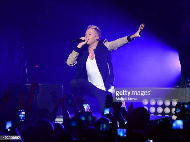 Macklemore Ryan Lewis perform for the 'American Express Membership Experiences Concert Series' at Club Nokia on June 6 2014 in Los Angeles California