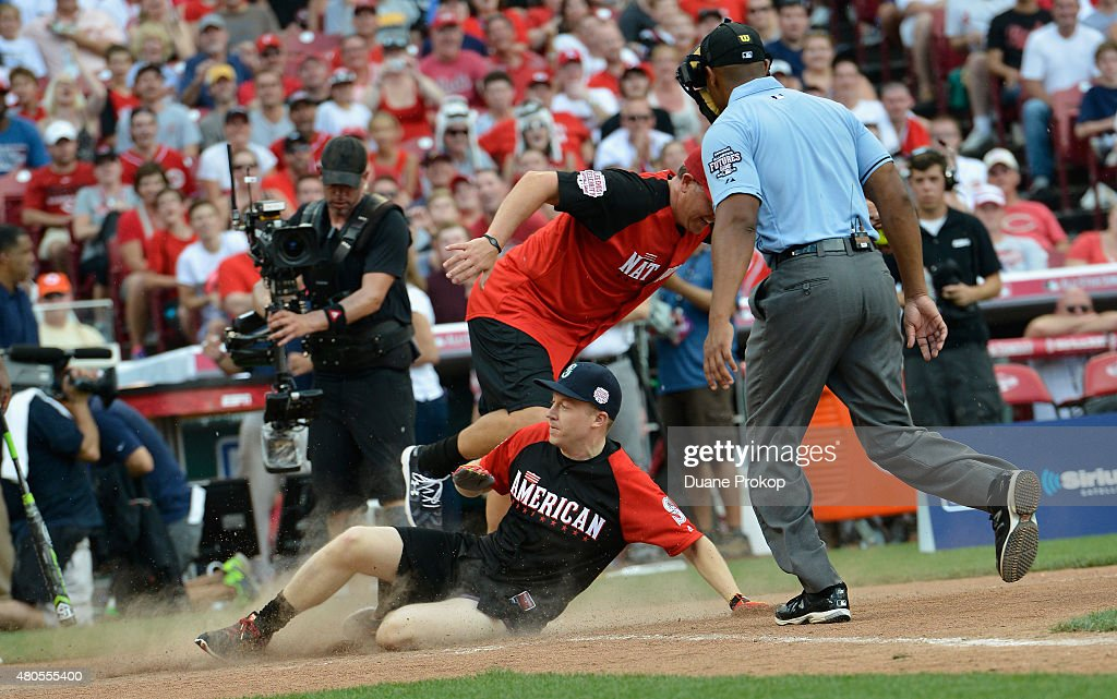 Macklemore slides to home base during the 2015 MLB All-Star Legends And Celebrity Softball Game at Great American Ball Park on July 12, 2015 in Cincinnati, Ohio.