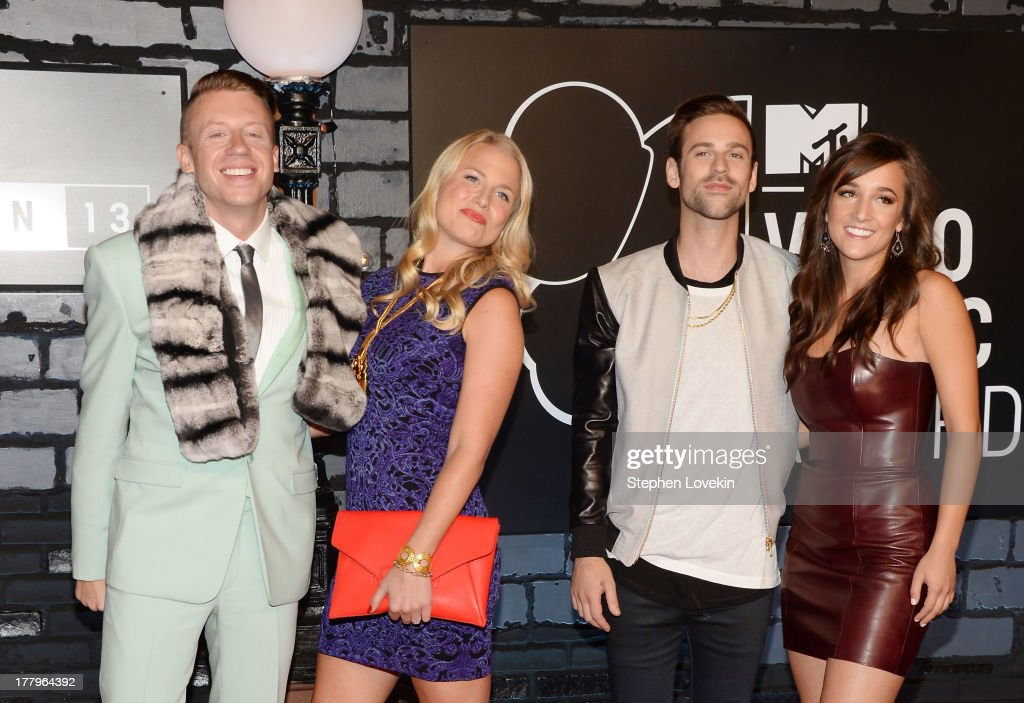 <a gi-track='captionPersonalityLinkClicked' href=/galleries/search?phrase=Macklemore&family=editorial&specificpeople=7639427 ng-click='$event.stopPropagation()'>Macklemore</a>, Tricia Davis, Ryan Lewis, and guest attend the 2013 MTV Video Music Awards at the Barclays Center on August 25, 2013 in the Brooklyn borough of New York City.