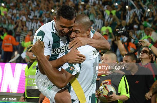 Macnelly Torres and Alexis Henriquez celebrate after winning a second leg final match between Atletico Nacional and Atletico Junior as part of Liga...