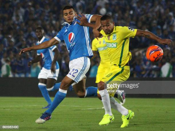 Macnelly Torres of Atletico Nacional fights for the ball with Jhon Duque of Millonarios during the match between Millonarios and Atletico Nacional as...