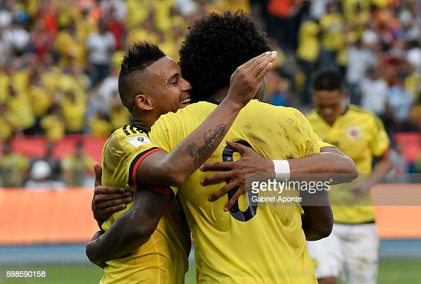 Macnelly Torres of Colombia celebrates with teammate Carlos Sanchez after scoring the second goal of his team during a match between Colombia and...